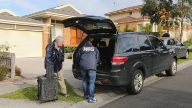Australian Federal Police conduct a raid on a house in Vermont South on Thursday.