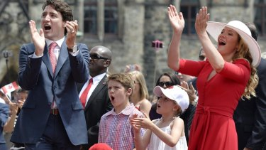 Canadian Prime Minister Justin Trudeau, his children Xavier and Ella-Grace, and wife Sophie Gregoire Trudeau cheer during Canada Day celebrations on Friday.