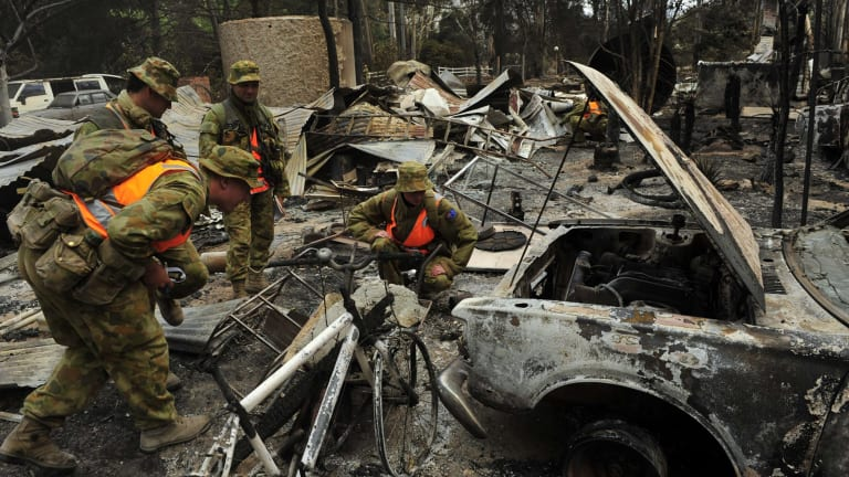 Army crews search for bodies in homes burnt during the 2009 Black Saturday bushfires.