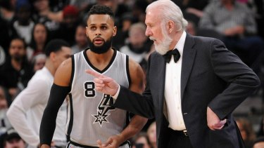San Antonio Spurs head coach Gregg Popovich, right, talks to Spurs guard Patty Mills, of Australia, during the second half of an NBA basketball game against the Dallas Mavericks, Sunday, Jan. 29, 2017, in San Antonio. Dallas won 105-101. (AP Photo/Darren Abate) Patty Mills and Gregg Popovich NBA San Antonio Spurs.