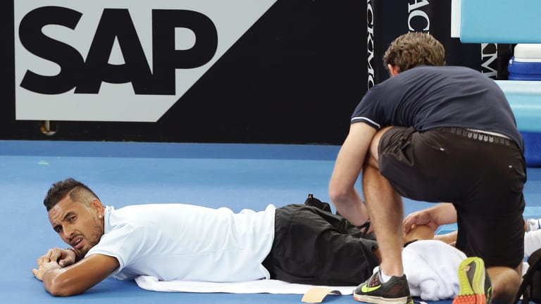 Injury scare: Nick Kyrgios is treated for an injury to his leg.