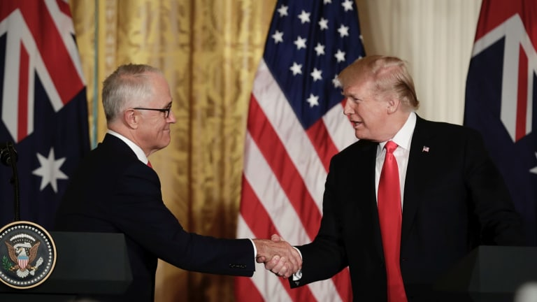 Prime Minister Malcolm Turnbull and United States of America President Donald Trump shake hands as they address the media during a joint press conference in the East Room at the White House during the Prime Minister's official visit to Washington DC.