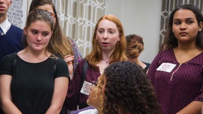 Lizzie Eaton, center, a 16-year-old survivor from Marjory Stoneman Douglas High School, directs a question to Senator Bobby Powell in his office at the Florida Capital in Tallahassee.