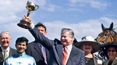 Trainer Bart Cummings lifts the Melbourne Cup after Rogan Josh, ridden by John Marshall claimed the 1999 Melbourne Cup.