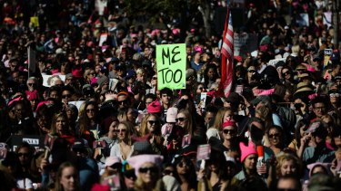 Protesters gather at the Grand Park for a Women's March against sexual violence and the policies of the Trump administration Saturday.