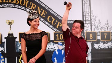 Cup of cheer: Stevie Payne reacts as Michelle Payne looks on during the Melbourne Cup barrier draw.