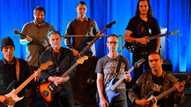 Members of the Melbourne Drone Orchestra, featuring 18 guitarists who use feedback, tones and volume to maximum effect.
