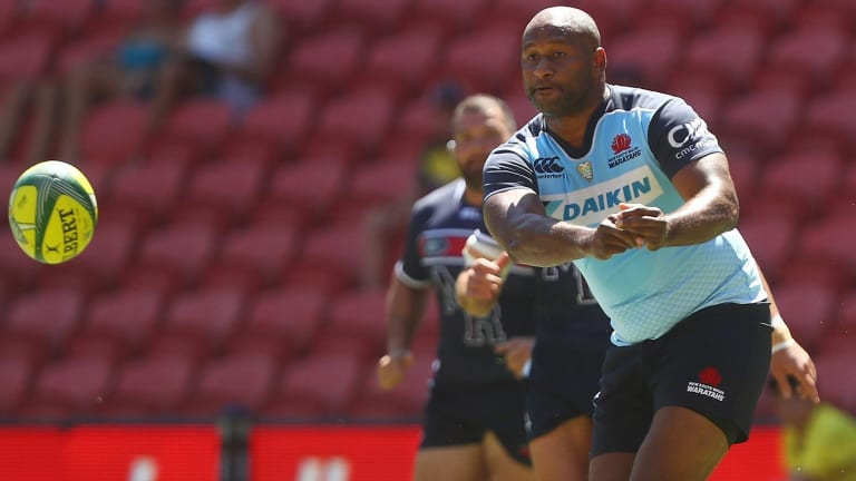Lote Tuqiri, of the Waratahs, passes during the Rugby Global Tens match between Waratahs and Rebels at Suncorp Stadium.