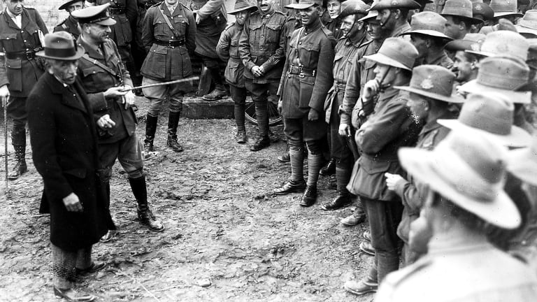 "Australian Prime Minister, W.M. ""Billy"" Hughes and General Sir John Monash, Australian Corps Commander, speak to an informal gathering of Australian troops near Le Mesnil, France, in 1918."