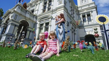 Kate Walsh with her children, Quinn, 5, Aidan, 4, and one-year-old Niamh at Leichhardt Town Hall after school care.