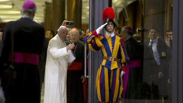 Pope Francis leaves at the end of the synod of bishops after calling for a more merciful and less judgmental Church.