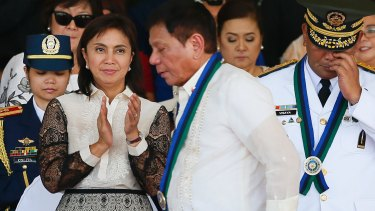 Vice-President Leni Robredo applauds as new Philippines President Rodrigo Duterte walks to address the troops during a ceremony in Quezon City in July.