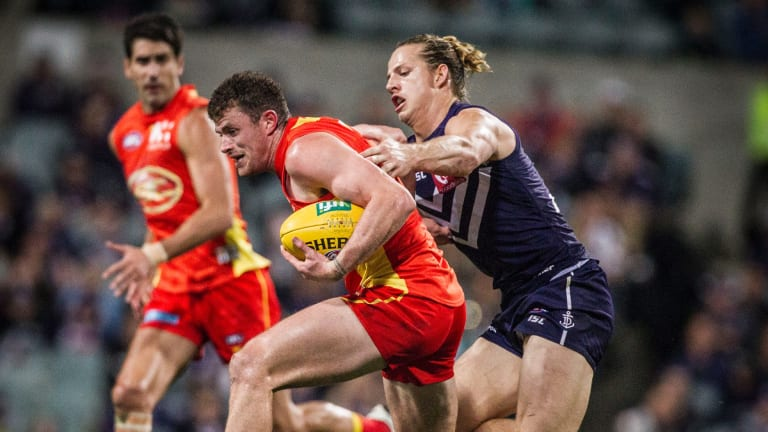 Gold Coast will host Fremantle at the new Perth Stadium in round three as Metricon Stadium will be unavailable.