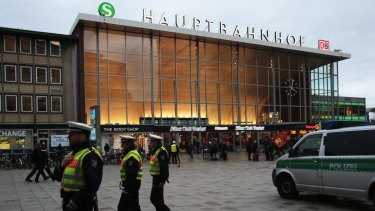 German police patrol in front of the central railway station in Cologne, where retaliatory attacks on immigrants have been reported.