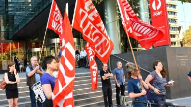 Injured workers rallied outside the Australia Post headquarters as Australia Post's outgoing CEO was grilled by a Senate estimates committee.