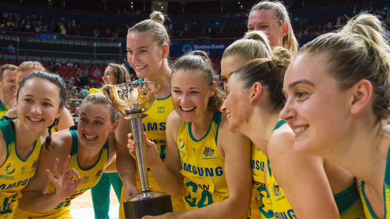 The victory spoils: Australian Diamonds pose with the trophy.