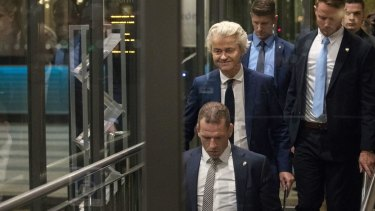 Geert Wilders, leader of the Freedom Party (PVV), centre, leaves the Dutch Parliament following the election.