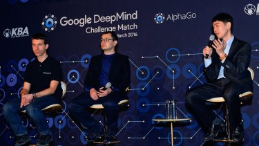 South Korean professional Go player Lee Se-dol, right, attends a press conference after the match against Google's artificial intelligence program, AlphaGo.