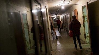 Intrepid visitors explore Mike Parr's Asylum.