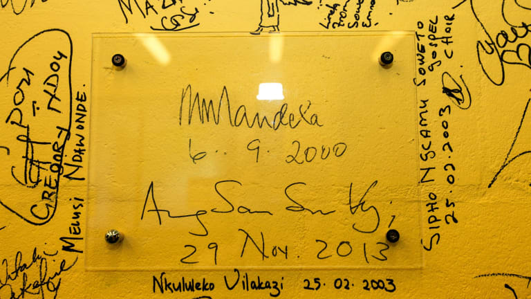 The wall of signatures at the ANU School of Music, seen here in 2013, includes some notable people, including Nelson Mandela and Aung San Suu Kyi.