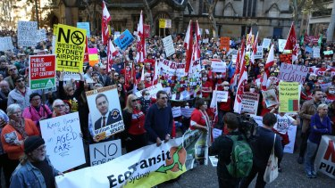 Protestors protest the policies of NSW Premier Mike Baird.