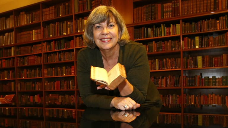 State Library of NSW's rare book expert, Maggie Patton, with the Bandello translation.
