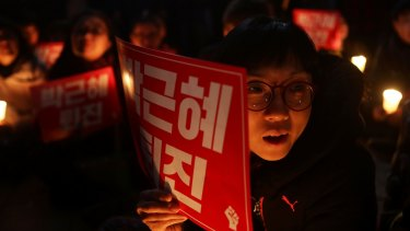Protesters call for South Korean President Park Geun-Hye to step down on Thursday.