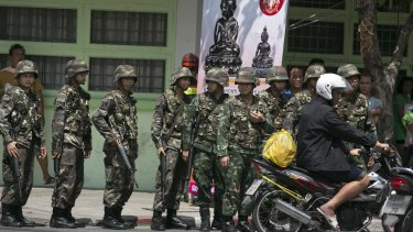 Thai soldiers patrol near government buildings last year after the army seized power.