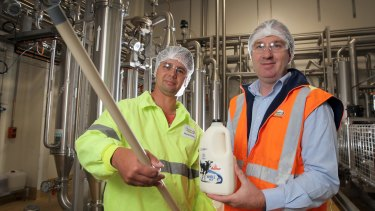 Fonterra Cobden production supervisor Brad Matin, holding one of the new microfiltration tubes, and production manager Brett Rowlands.