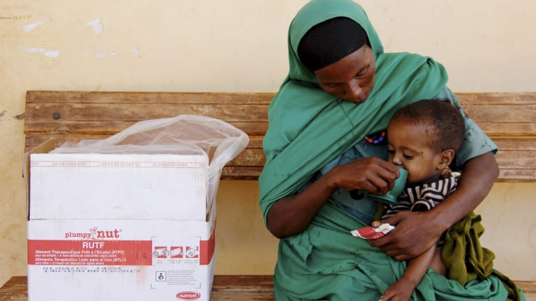 Two-year-old Seid eats high nutrient peanut paste provided by Save the Children's Health Extension Worker.