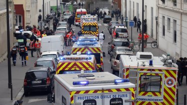 January 7, 2015: Ambulances gather in the street outside the French satirical newspaper Charlie Hebdo's office after masked gunmen stormed the newspaper, killing 12 people.