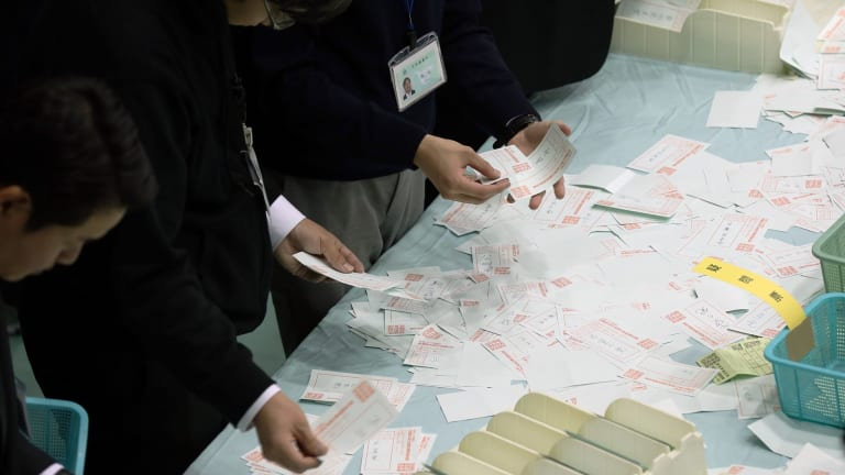 Electoral officials count ballots in Himeji, Hyogo, Japan, on Sunday.