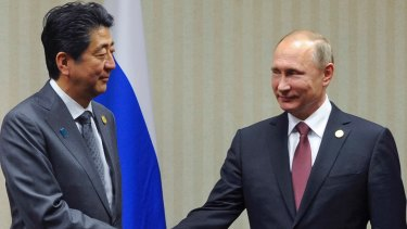Japanese Prime Minister Shinzo Abe, left, with Russian President Vladimir Putin during their APEC meeting in Lima in November.