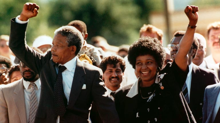 Nelson Mandela and his wife Winnie, walk hand in hand, raising clenched fists after his release from Victor Verster Prison, Cape Town, in 1990 after 27 years in detention.
