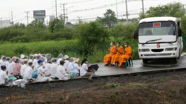 Monks and worshippers block the road outside the Dhammakaya Temple, north of Bangkok, last year.