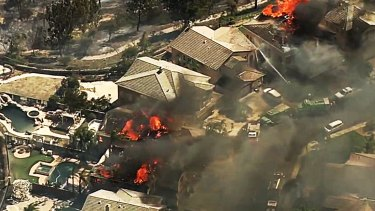Wildfires whipped by powerful winds swept through northern California forcing evacuations as homes burnt.