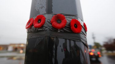 Poppies on a lamp post in front of the Service Canada building in the Quebec town of Saint-Jean-sur-Richelieu, where two soldiers were attacked, one of them fatally.
