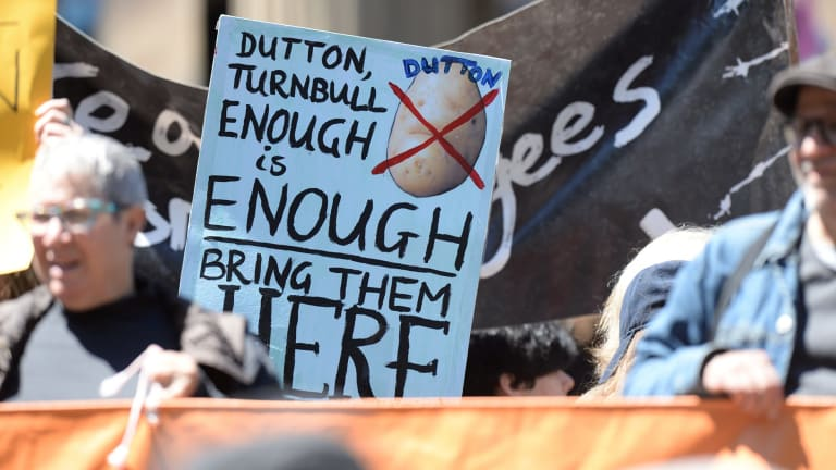 'Bring them here' reads a protester's sign in support of asylum seekers on Manus Island.