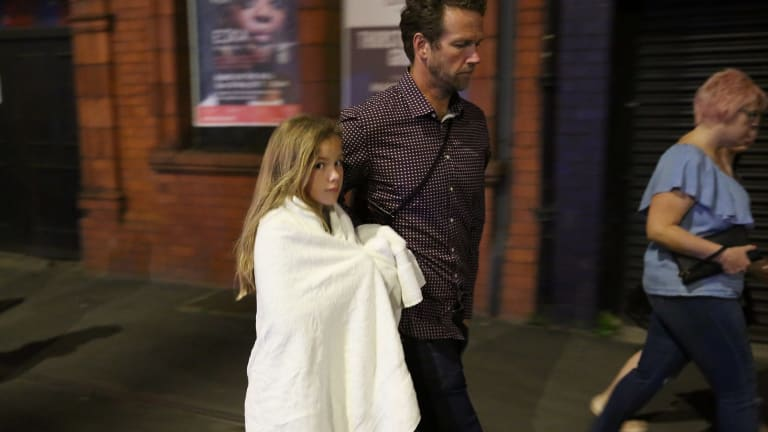 A young music fan leaves the arena following the attack.