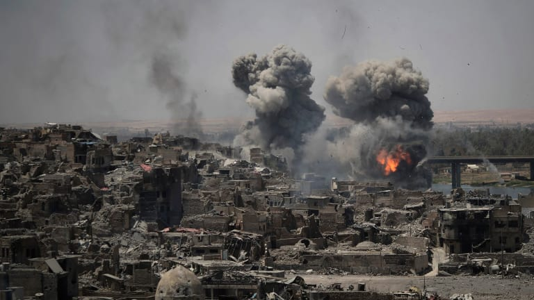 Airstrikes target Islamic State positions on the edge of the Old City in Mosul, Iraq in July.