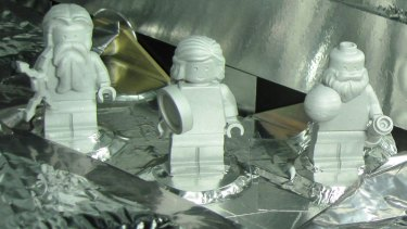 Lego figurines representing, from left, the Roman god Jupiter, his wife, Juno, and Galileo Galilei aboard the Juno spacecraft. The figures are made of aluminium so they can withstand the extreme conditions of space flight.