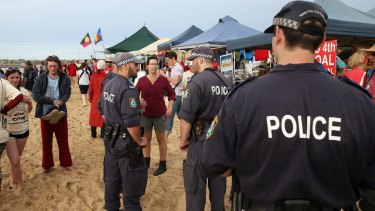 Police move on the beach towards the end of the protest.