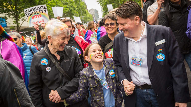 Victorian Commissioner for Gender and Sexuality Ro Allen (right), her partner Kaye Bradshaw and their daughter, Alex Bradshaw-Allen, 9, turned out in support of the same-sex marriage ''yes'' vote in an Equal Love rally through Melbourne's CBD on Sunday.
