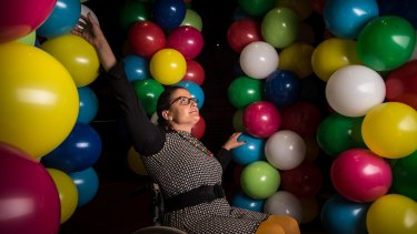 Artist Noemi Lakmaier will be lifted up by 20,000 balloons for nine hours at Sydney Opera House on Sunday.