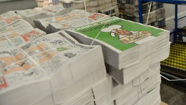 The first edition of <i>Charlie Hebdo</i> after militants attacked the French satirical newspaper sold out quickly.