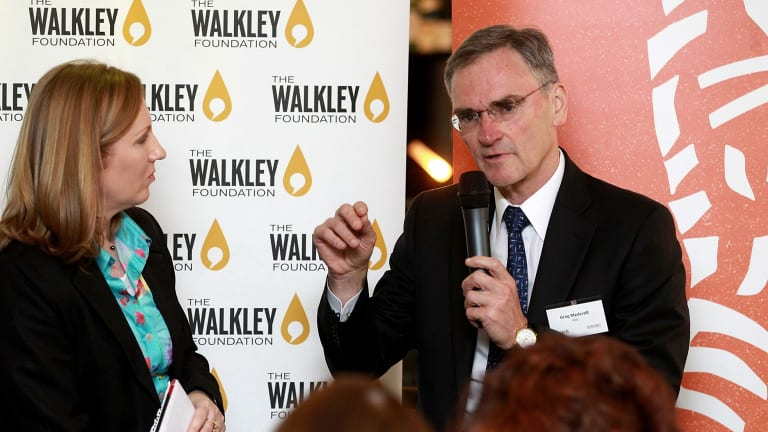 ASIC chief executive Greg Medcraft speaks at a Walkley lunch with  Adele Ferguson in Sydney in 2014.