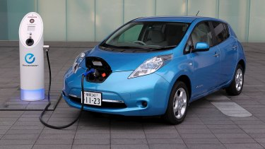 A Nissan Leaf electric car is recharged.