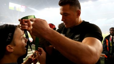 Touching gesture: Sonny Bill Williams hands his medal to young fan Charlie Line.
