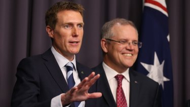 Christian Porter and Federal Treasurer Scott Morrison. Mr Porter has been accused of failing to fight for a fairer GST deal.