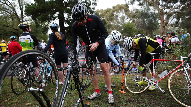 A cyclist fixes a puncture after hitting a tack during a protest that involved over 1000 bike riders who rode 13km's around Kew Boulevard to protest against someone who had been laying tacks on the road.